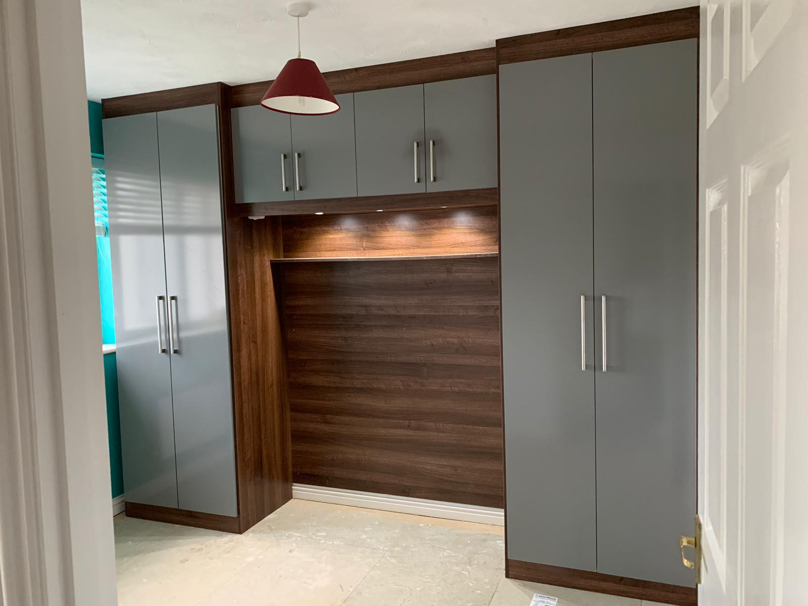 Two Tone Bespoke Fitted Wardrobe unit utilizing a High Gloss With Premium LED Lighting